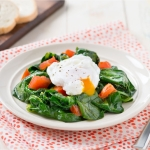 Poached Eggs with Spinach and Tomato Sauté