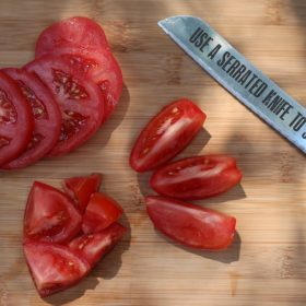use a serrated knife to slice tomatoes