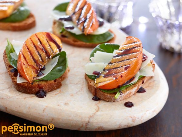 Grilled Persimon® Crostini with Manchego and Wine Reduction