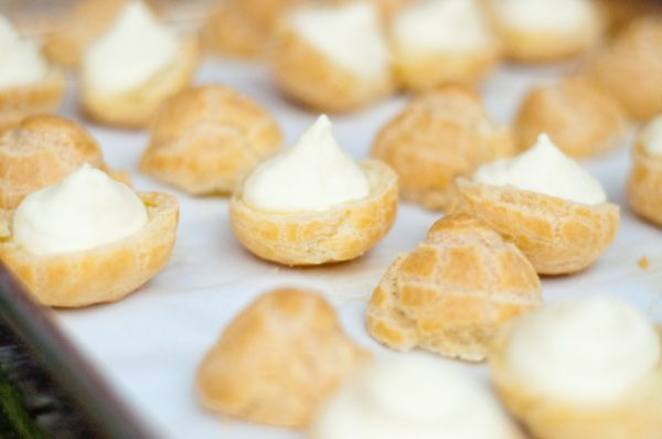 Passion fruit cream puffs being filled by Mardi Michels eatlivetravelwrite.com