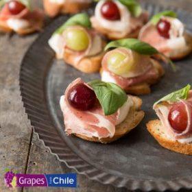 Grape, Burrata and Prosciutto Crostini
