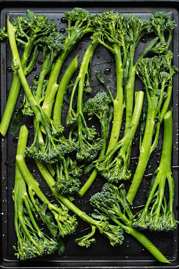 Broccolini on a baking sheet